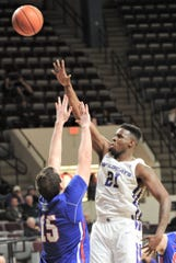 ACU's Jalone Friday, right, shoots over Houston Baptist's Edward Hardt in the second half. ACU beat the Huskies 75-68 in the Southland Conference game Wednesday, Jan. 16, 2019, at Moody Coliseum.