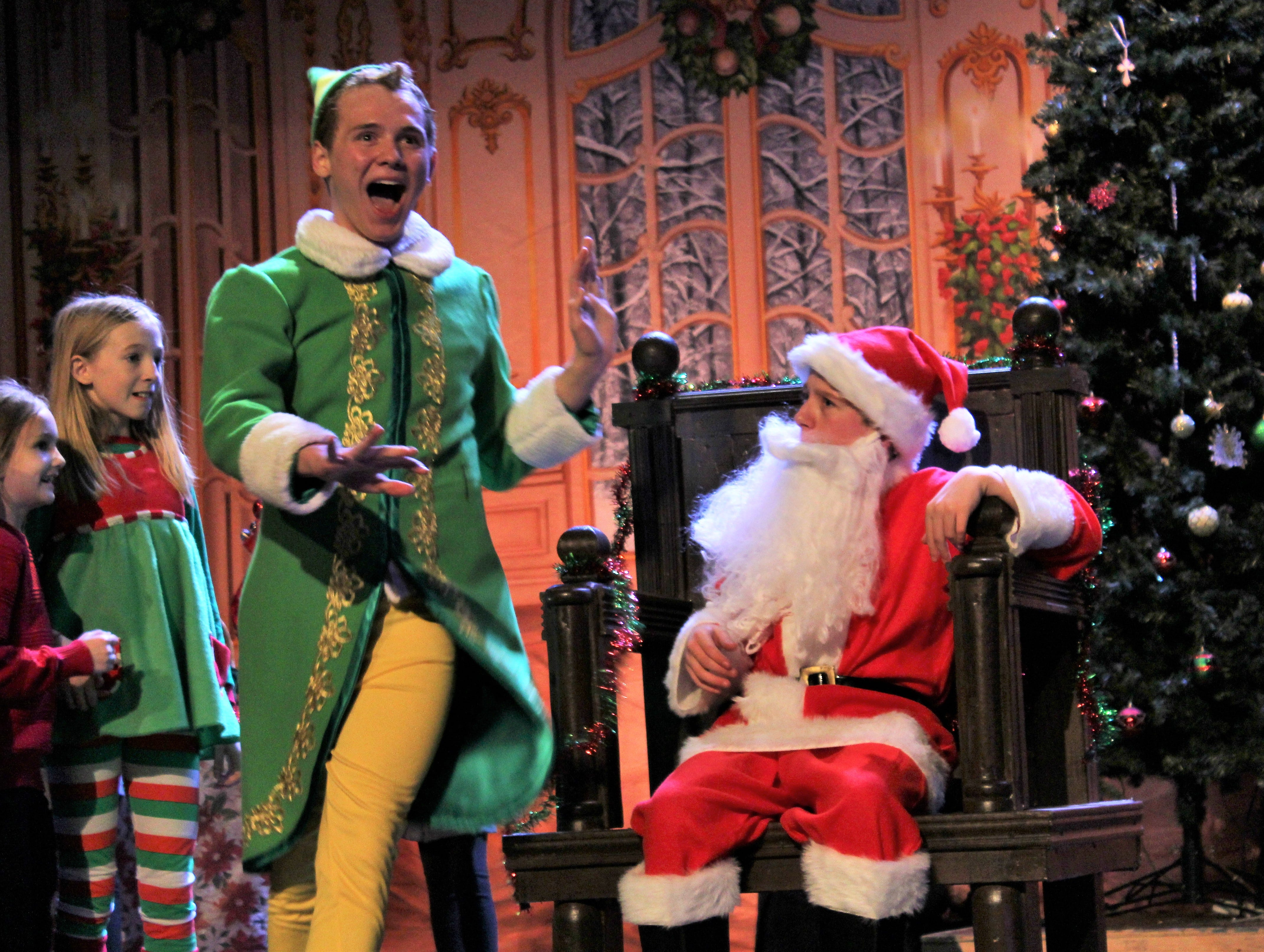 "Buddy (Brent Bardin) disrupts time with Santa (Jax Melbourne) in a New York City department store with his claims that Santa is fake in this rehearsal scene from ""El, the Musical, Jr."" at the Paramount Theatre."