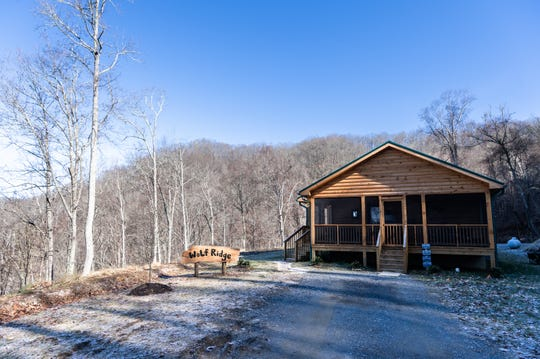 The log cabin home of Vangie Stephens and Tommy Stephens in Cherokee designed by Vangie.