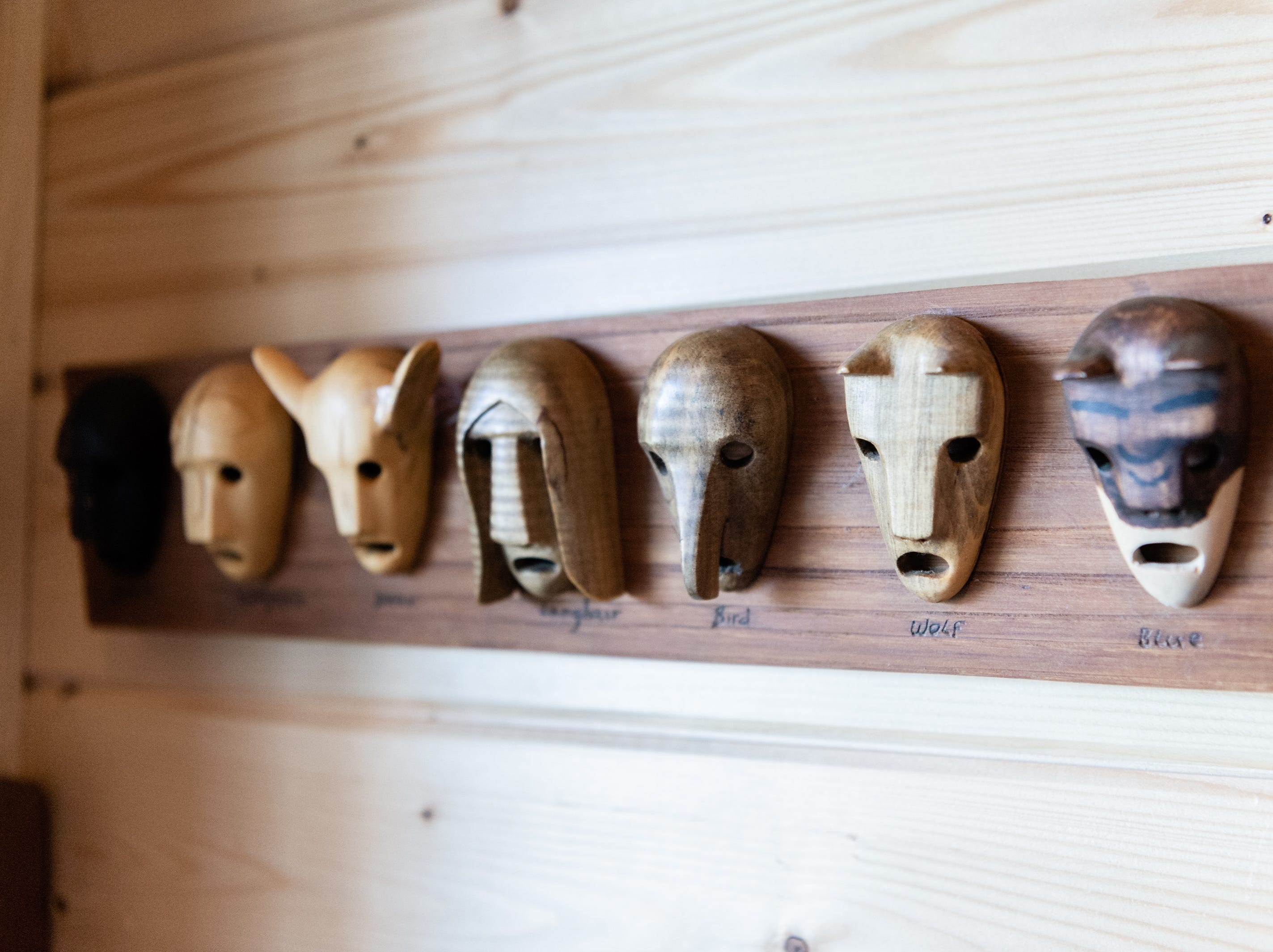 Masks representing the seven Cherokee clans in the log cabin home of Vangie Stephens and Tommy Stephens in Cherokee which was designed by Vangie.