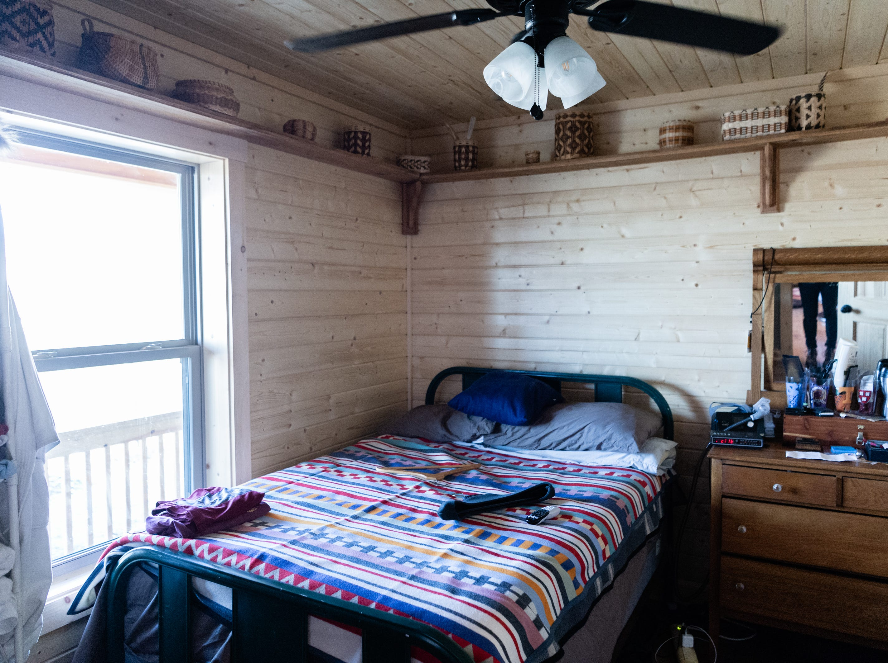 A bedroom in the log cabin home of Vangie Stephens and Tommy Stephens in Cherokee which was designed by Vangie.