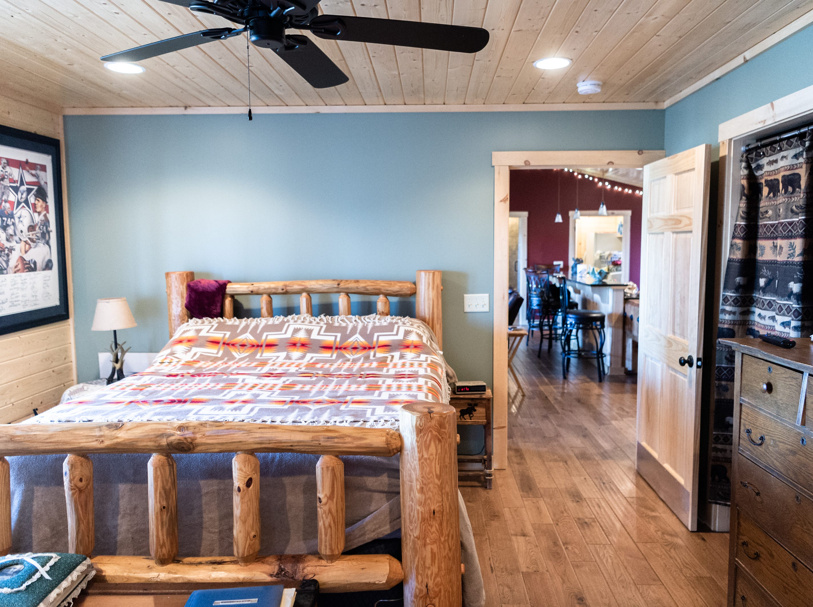 The master bedroom in Vangie Stephens' and Tommy Stephens' log cabin home in Cherokee, designed by Vangie.