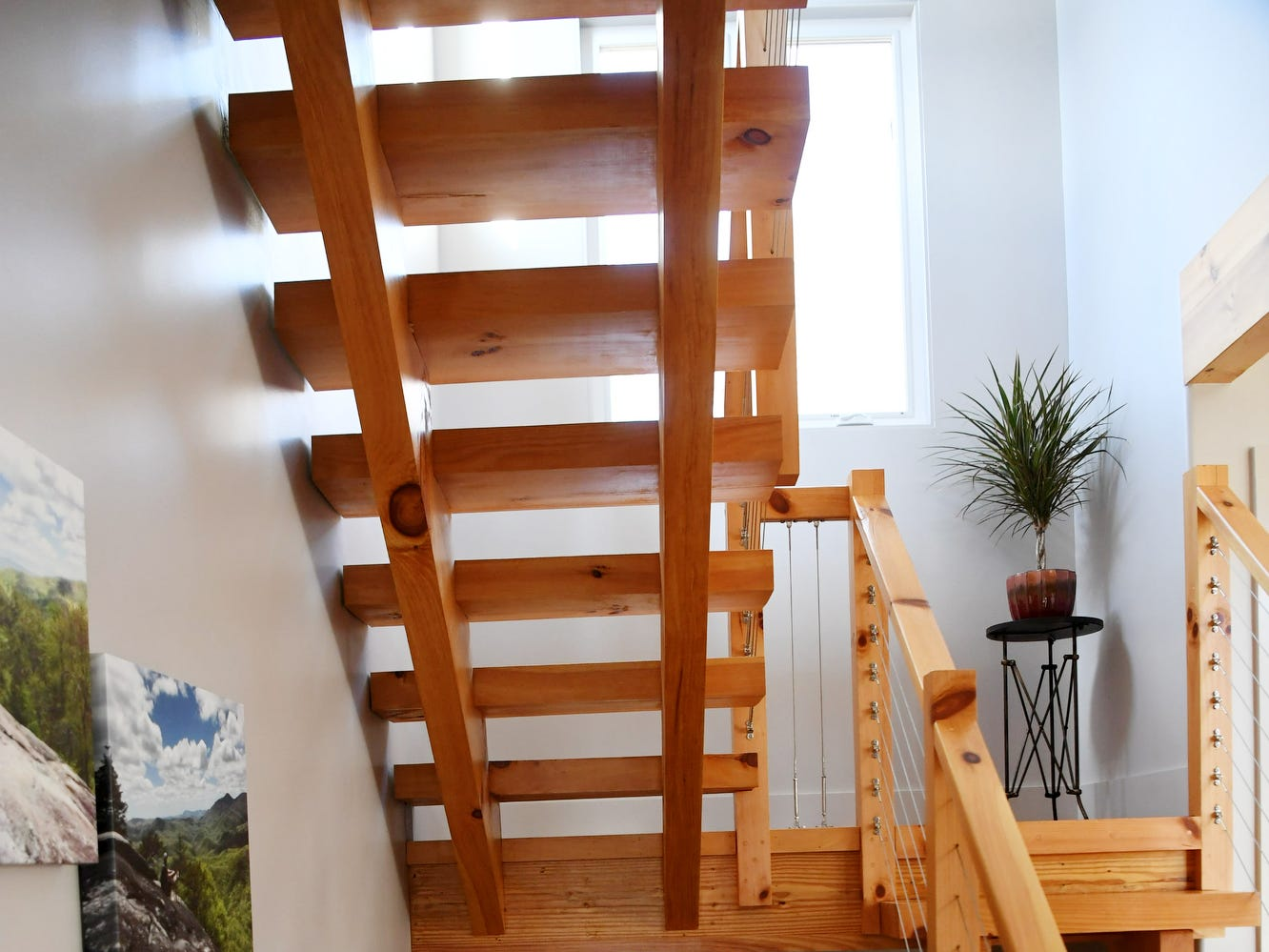 The wooden staircase in Matthew Rooks' Asheville home.