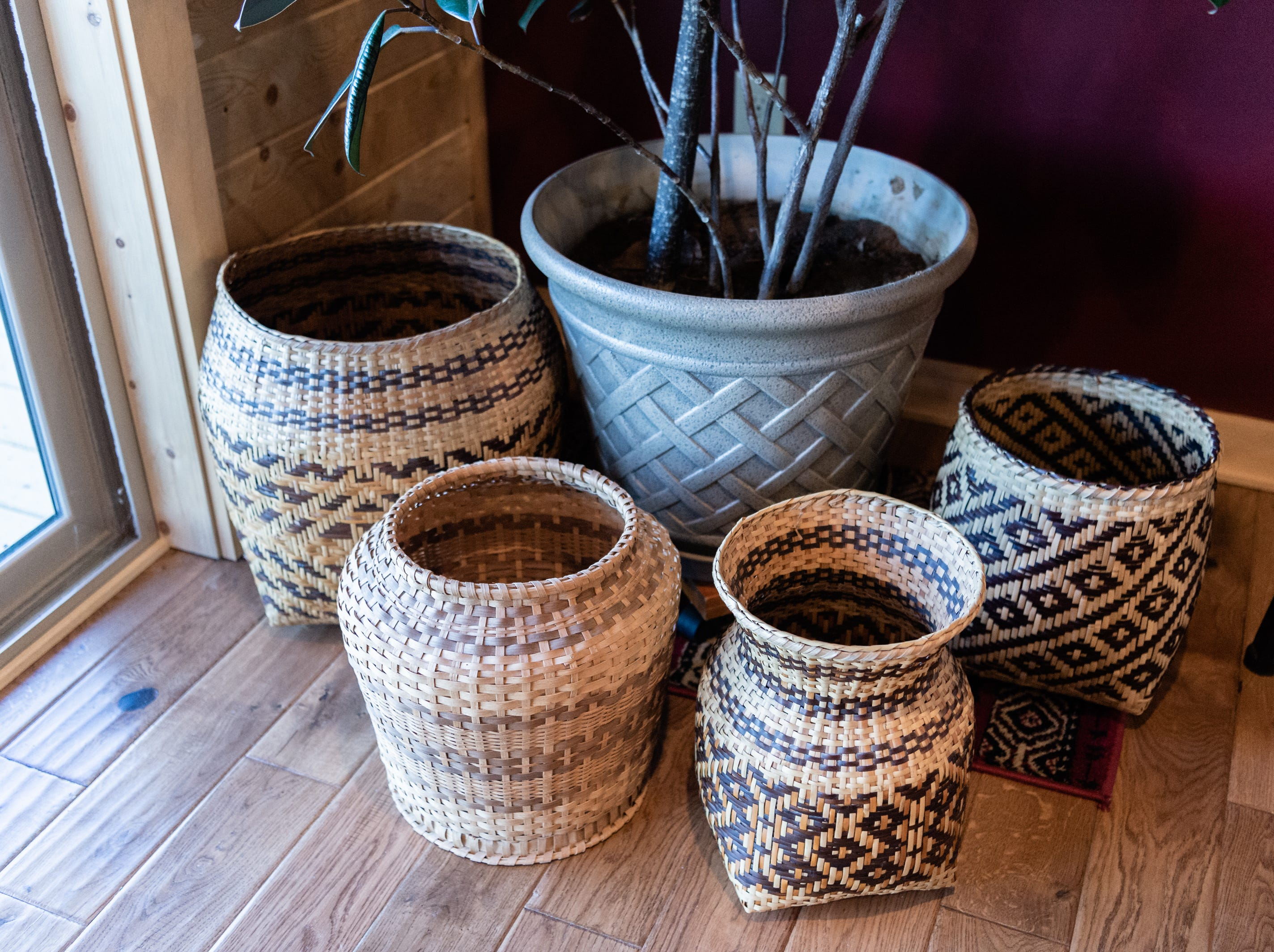 Woven Cherokee baskets in the log cabin home of Vangie Stephens and Tommy Stephens in Cherokee which was designed by Vangie.