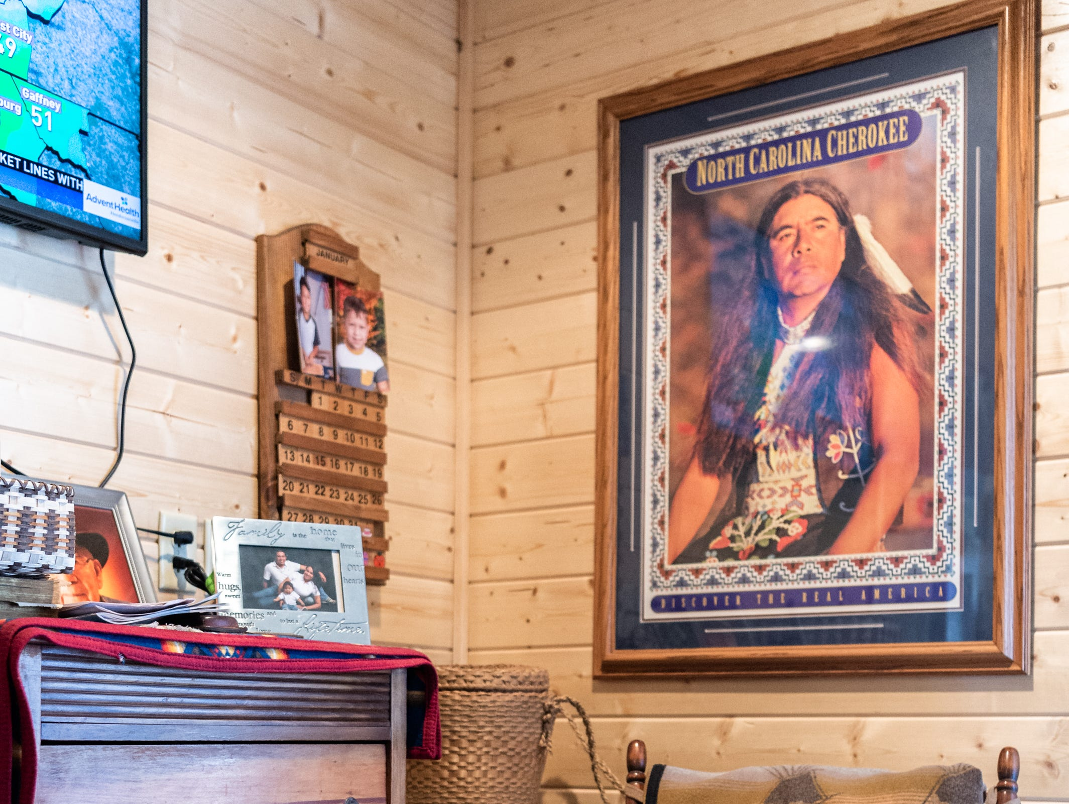A portrait of Dennis Wolf in the master bedroom of Wolf's sister, Vangie Stephens and her husband Tommy Stephens in their log cabin home in Cherokee which was designed by Vangie.