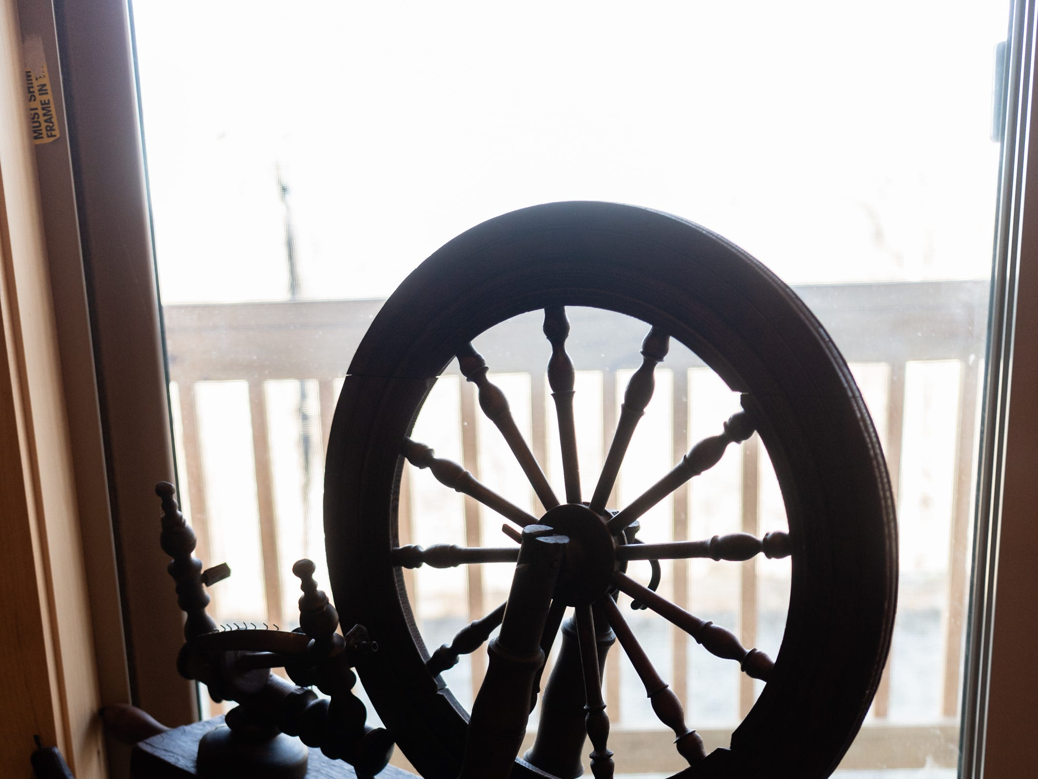 An antique spinning wheel in the log cabin home of Vangie Stephens and Tommy Stephens in Cherokee which was designed by Vangie.
