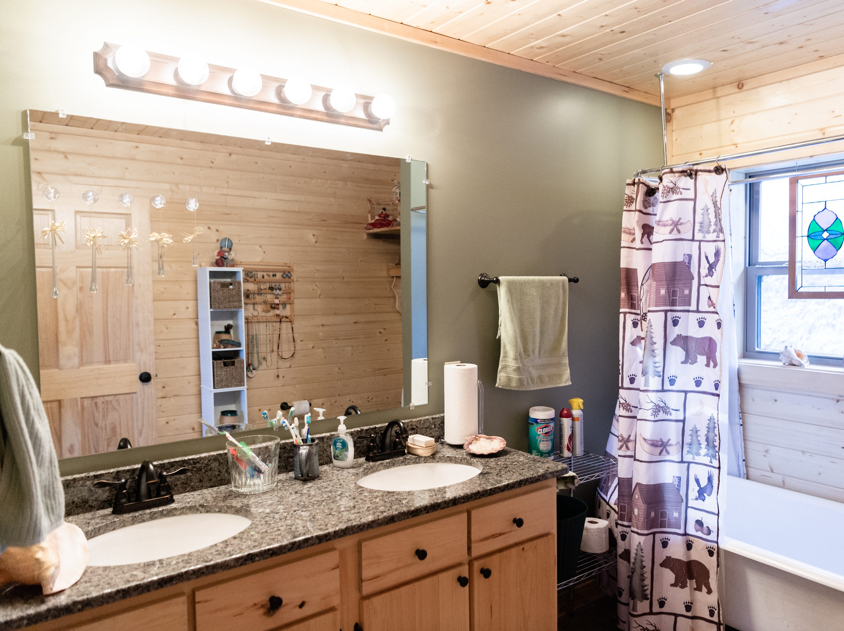 The master bathroom in the log cabin home of Vangie Stephens and Tommy Stephens in Cherokee which was designed by Vangie.