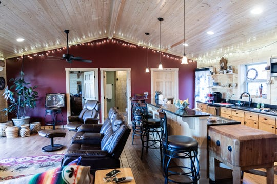 The kitchen and living room in the log cabin home of Vangie Stephens and Tommy Stephens in Cherokee which was designed by Vangie.
