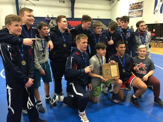 Chenango Forks wrestlers celebrate with their hardware after winning the Section 4 Division I Dual Meet Tournament on Wednesday at Forks.