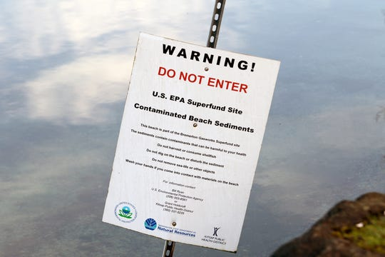 An EPA superfund site warning where a pair of ballast tanks rest on the beach near the Bridgeview Marina in West Bremerton.