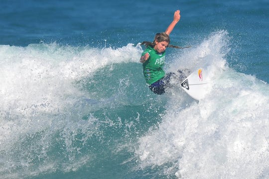 Surfer Caroline Marks, a Melbourne Beach native, soared to three heat victories Thursday to reach the semifinals.