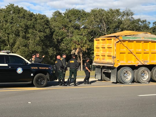 Dump trucks were stopped on Heritage Parkway Thursday by authorities checking for overloads.