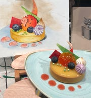 Food becomes art, or the other way around, as illustrated by this lemon-blood orange tart, which is being served at the Epcot International Festival of the Arts.