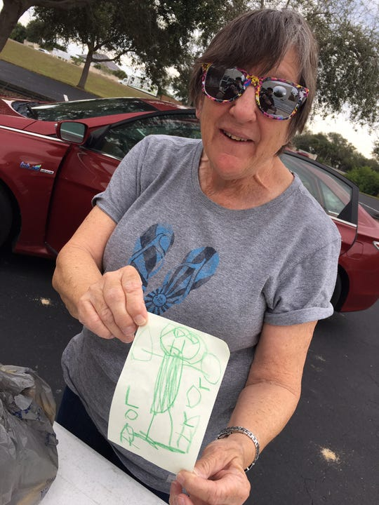 Brevard resident Pat Snyder shows a picture her 5-year-old granddaughter, Lola, drew as a thank-you note for those served by Operation Gratitude.