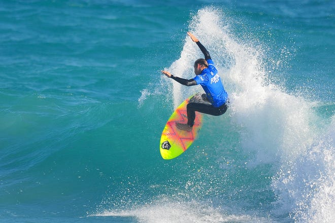 Surfer Chauncey Robinson of Florida Beach soars during January's Florida Pro Surf competition at Sebastian Inlet State Park.
