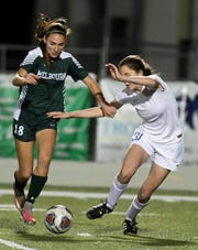 Jordan Smith of Melbourne (left) won this week's FLORIDA TODAY Community Credit Union Athlete of the Week online vote.