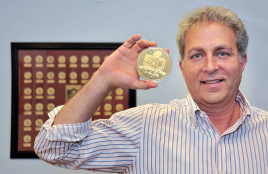 Michael Kott, CEO of the The Highland Mint in Melbourne, oversees the manufacture of the coin used in the Super Bowl. He's hoping for a match up between the Kansas City Chiefs and the New Orleans Saints, with a Chief victory, for the best coin sales.