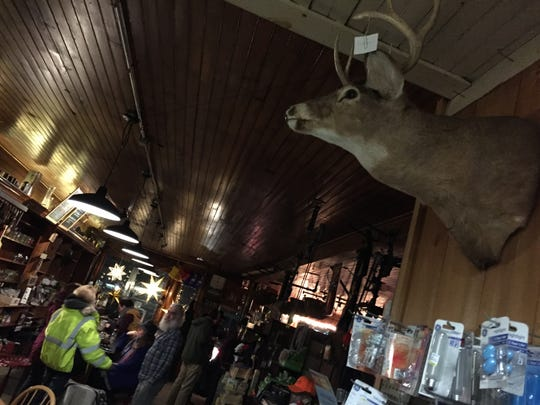A buck watches over the action at The Den at Harry's Hardware in Cabot on Jan. 12, 2019.