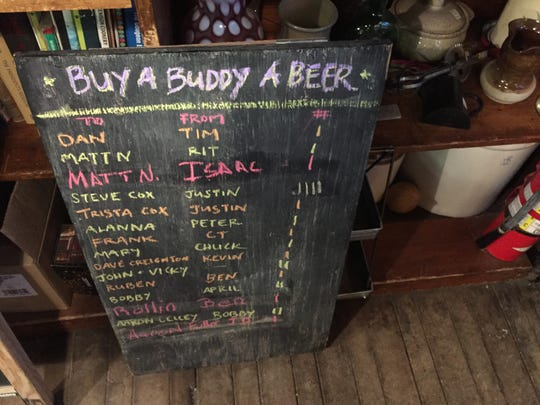 Customers can buy a beer for future customers at The Den at Harry's Hardware in Cabot.