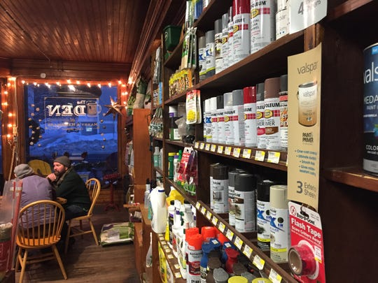 Customers enjoy pints of beer near shelves of Rust-Oleum at Harry's Hardware in Cabot on Jan. 12, 2019.