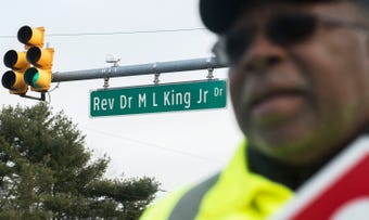 Crossing guard Gilbert Spriggs speaks on the naming of Rev. Dr. M. L. King Jr. Drive in Willingboro