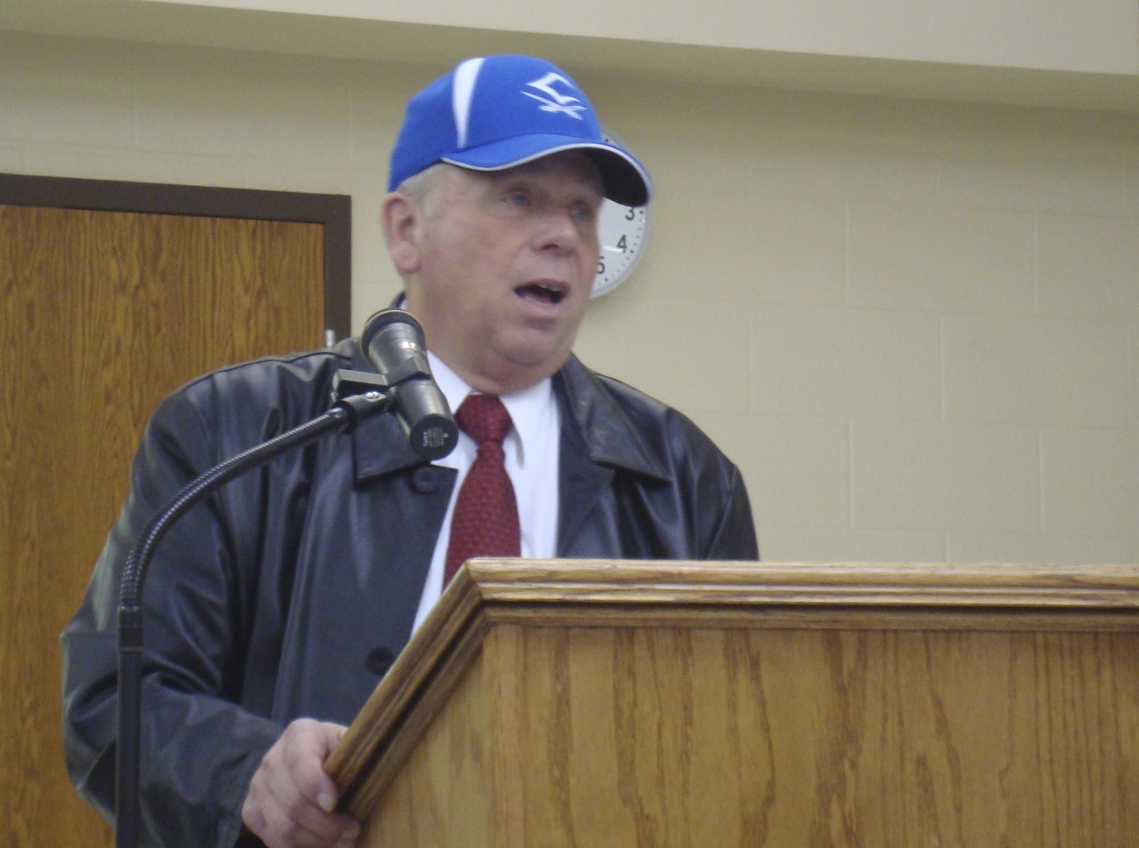 Chillicothe Head Football Coach Ron Hinton speaks briefly at a school board meeting Monday. Hinton was just approved as the new head coach.
