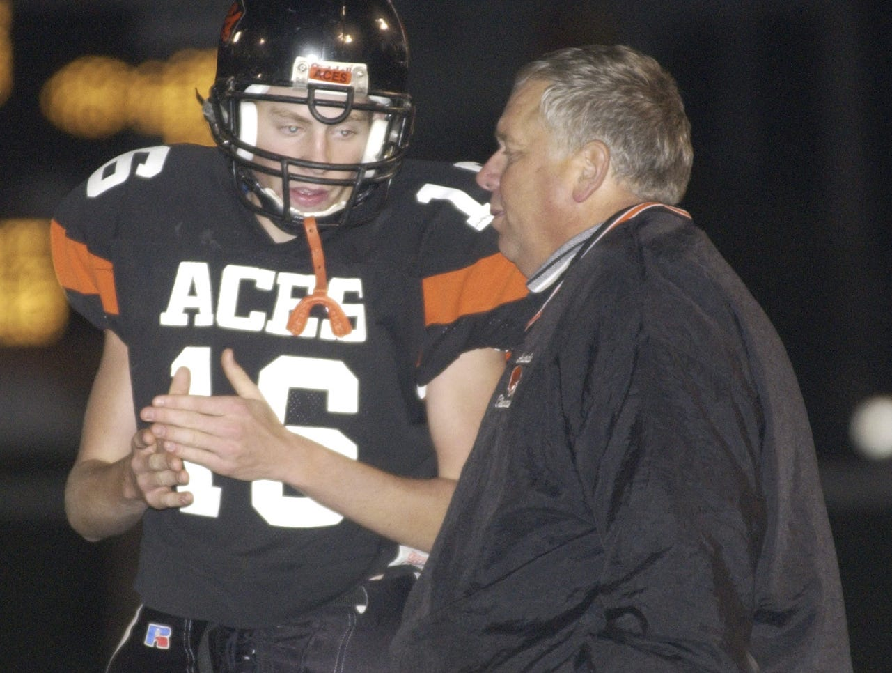 Amanda-Clearcreek's head coach, Ron Hinton, talks with Kyle McCalla during the third quarter of the game Friday night. The Aces defeated Hamilton Twp. 68-7.