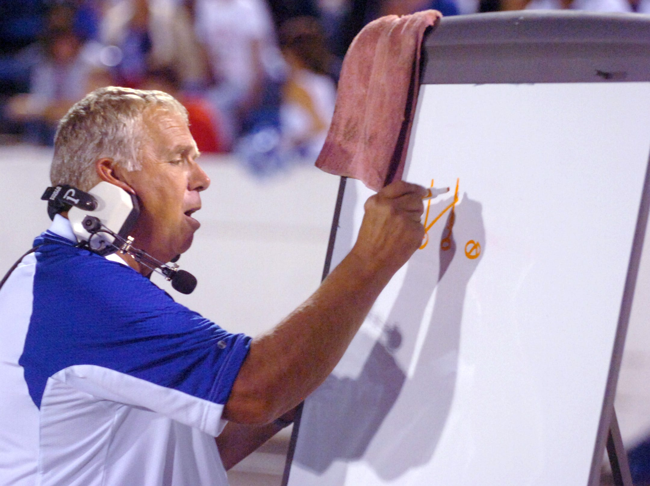 Chillicothe football coach Ron Hinton diagrams a play during the last year's home game against Ironton in September 2010.