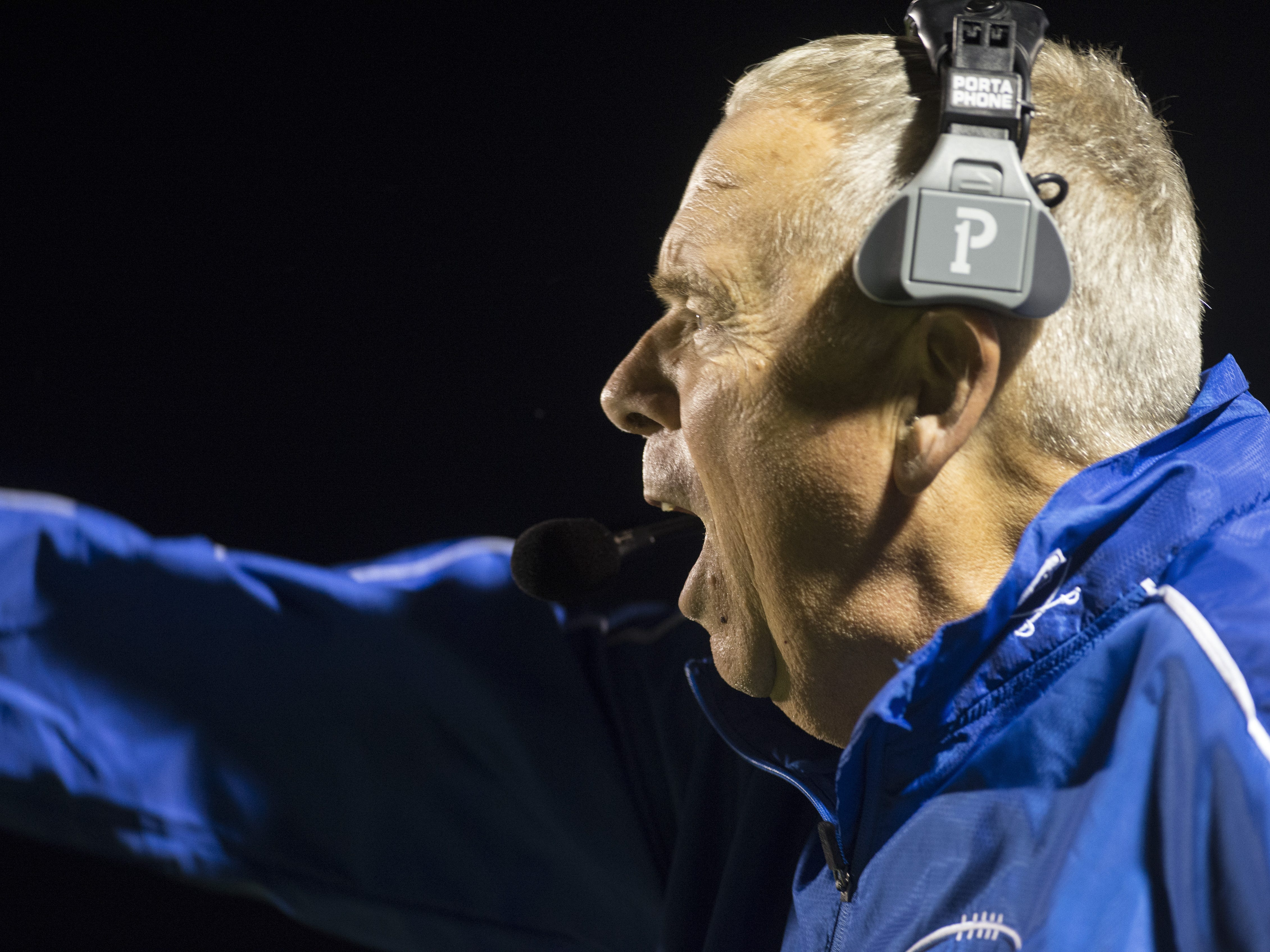 Chillicothe head coach Ron Hinton yells from the sidelies as the Cavaliers take on the  Hillsboro Indians at Richards Memorial Field on Friday, Sept. 28, 2018. The Cavaliers defeated the Indians 36-30.