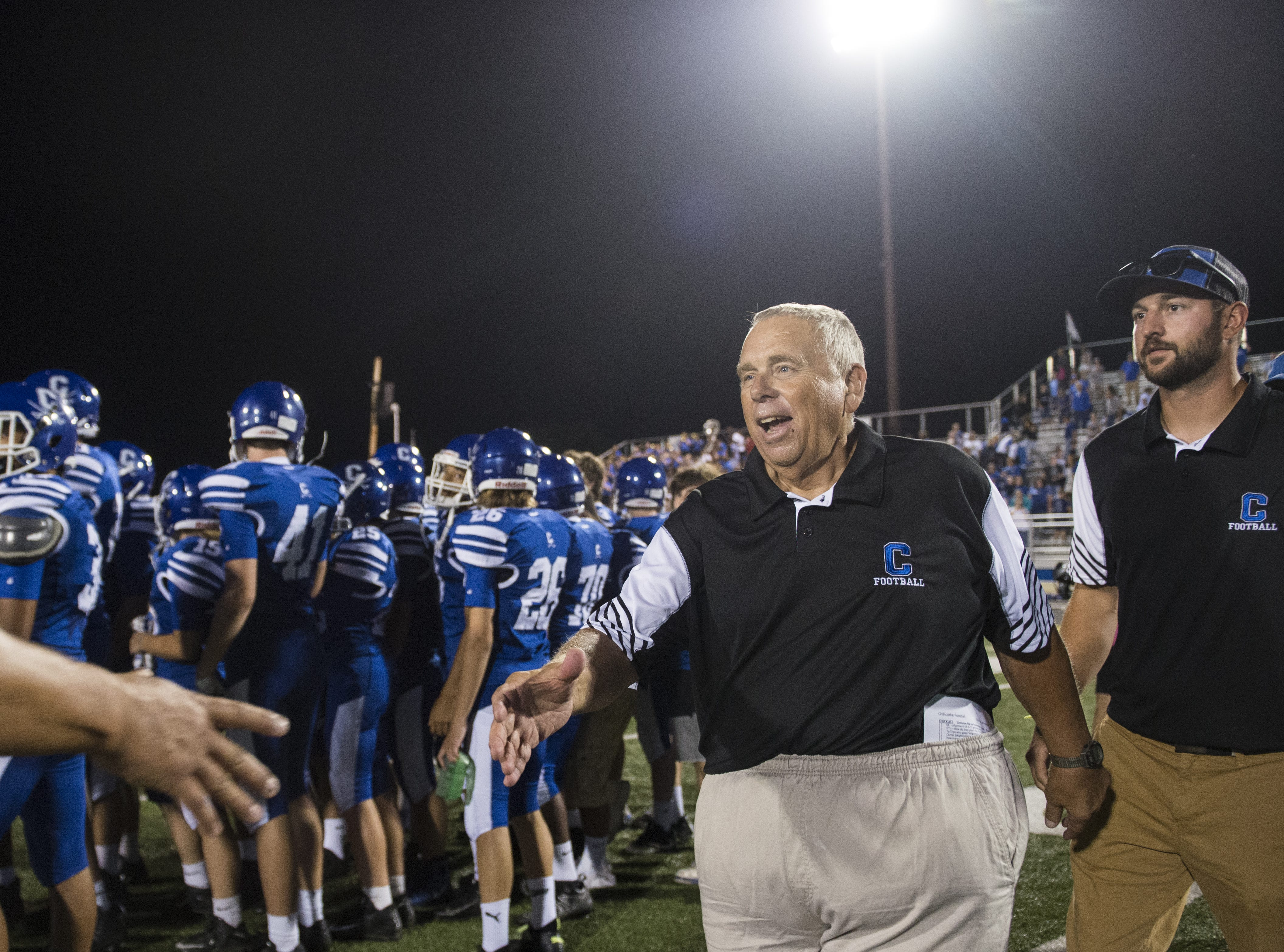 Chillicothe's head coach Ron Hinton rejoices as the Cavaliers defeat the Vikings 14-13 at Harris Family Complex on Friday, August 24, 2018.