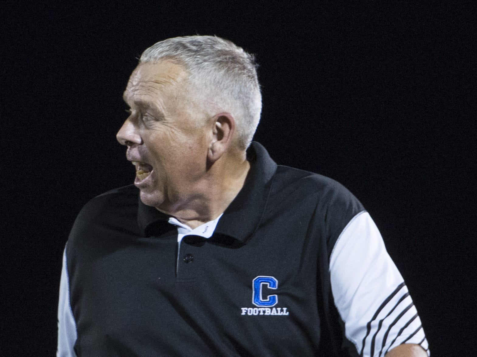 Chillicothe's head coach Ron Hinton yells in response to a referee's call at Logan High School on Friday, Sept. 21, 2018. The Cavaliers defeated the Logan High Chieftains 7-6.