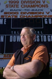 Ron Hinton, football coach for Amanda-Clearcreek High School, poses for a portrait at the A-C field shortly before his induction in the Ohio High School Football Coaches Hall of Fame.