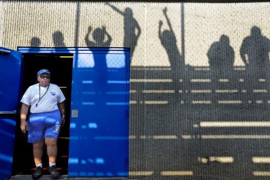 Chillicothe High School Head Football Coach Ron Hinton emerges  from the locker room, ready to begin biddie and junior high football camp at Herrnstein Field in this file photo.