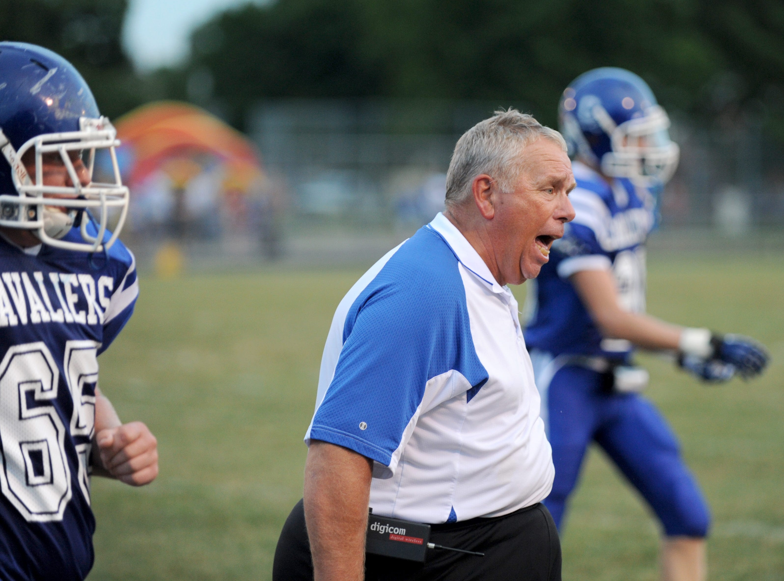 Chillicothe head coach Ron Hinton coaches the Cavaliers against Big Walnut High School in the 2012 season home opener in August at Herrnstein Field.
