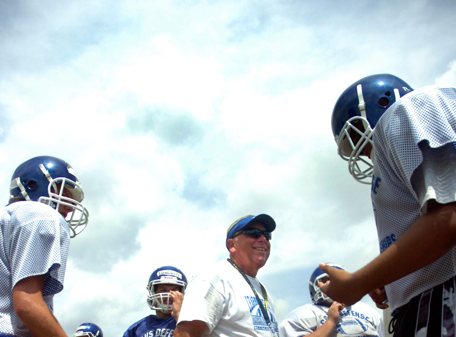 Chillicothe High School Head Football Coach Ron Hinton talks with players during practice on Thursday, August 5, 2010 at Herrnstein Practice Field.