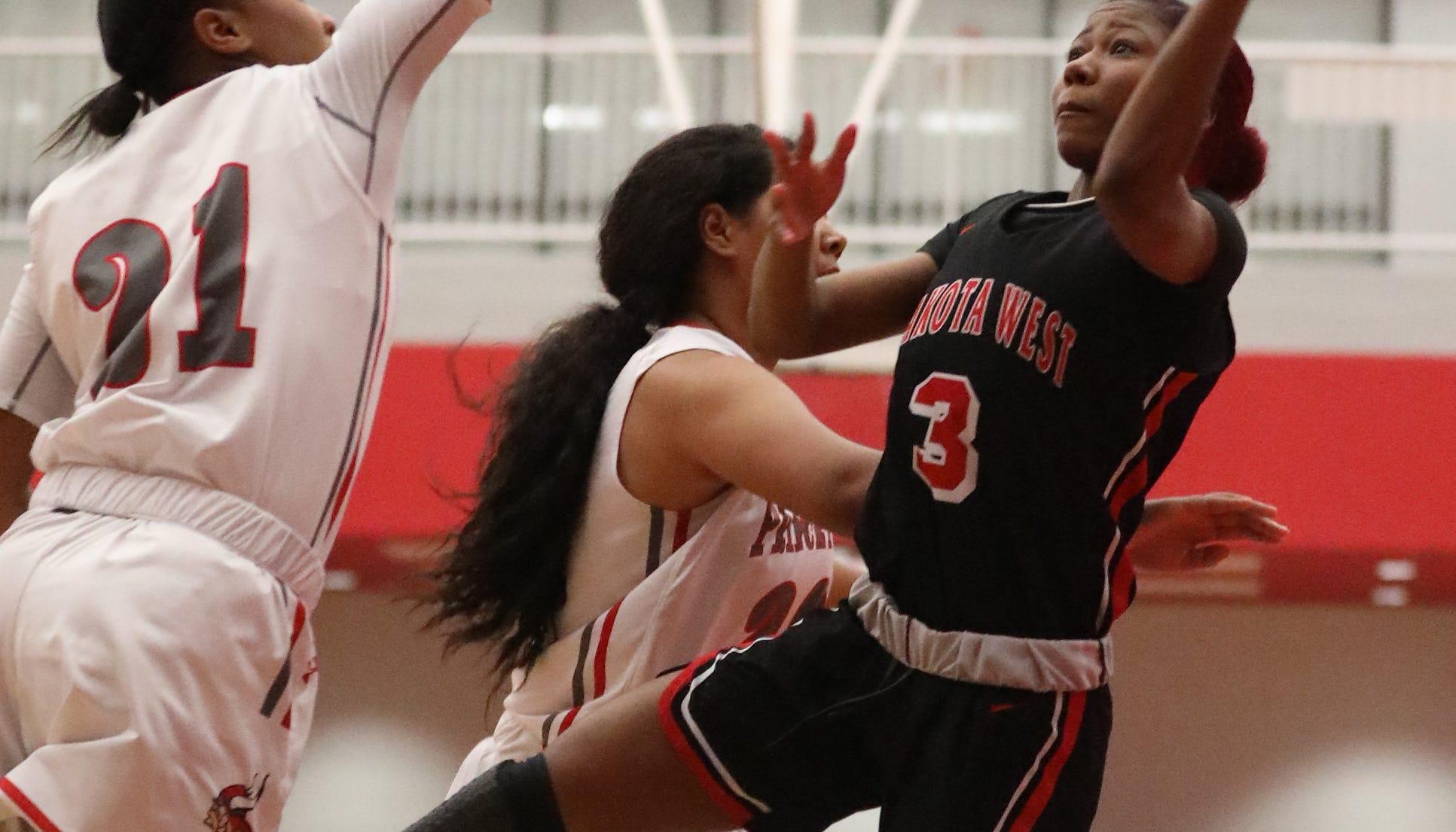 Lakota West guard Sydney Benning (1) shoots over Princeton guard Willow White (21) during their basketball game  Wednesday, Jan.16,2019.