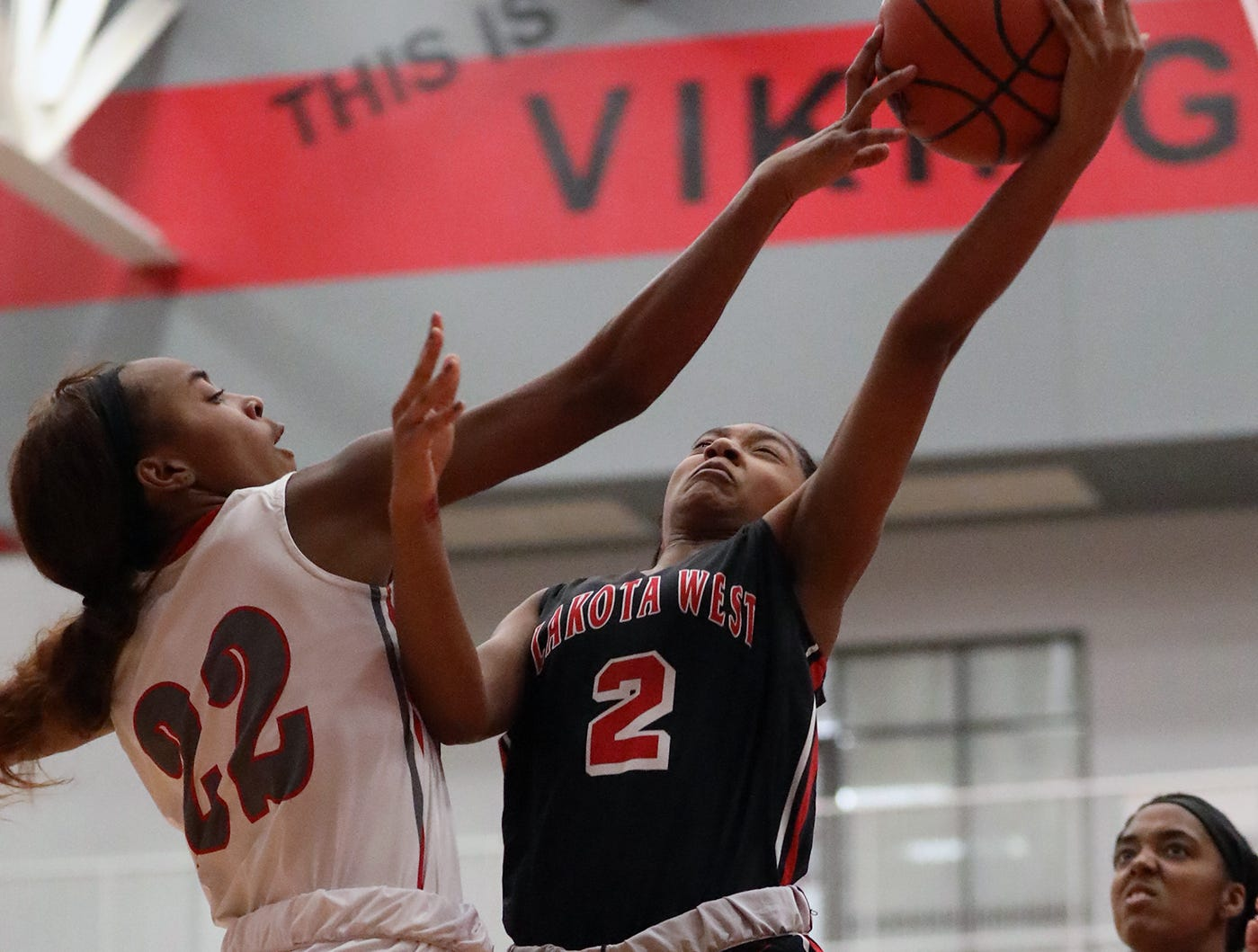 Lakota West  guard Chance Gray (2) drives to the basket against Princeton forward Jacquelyn Hinessmon during their basketball game, Wednesday, Jan.16,2019.