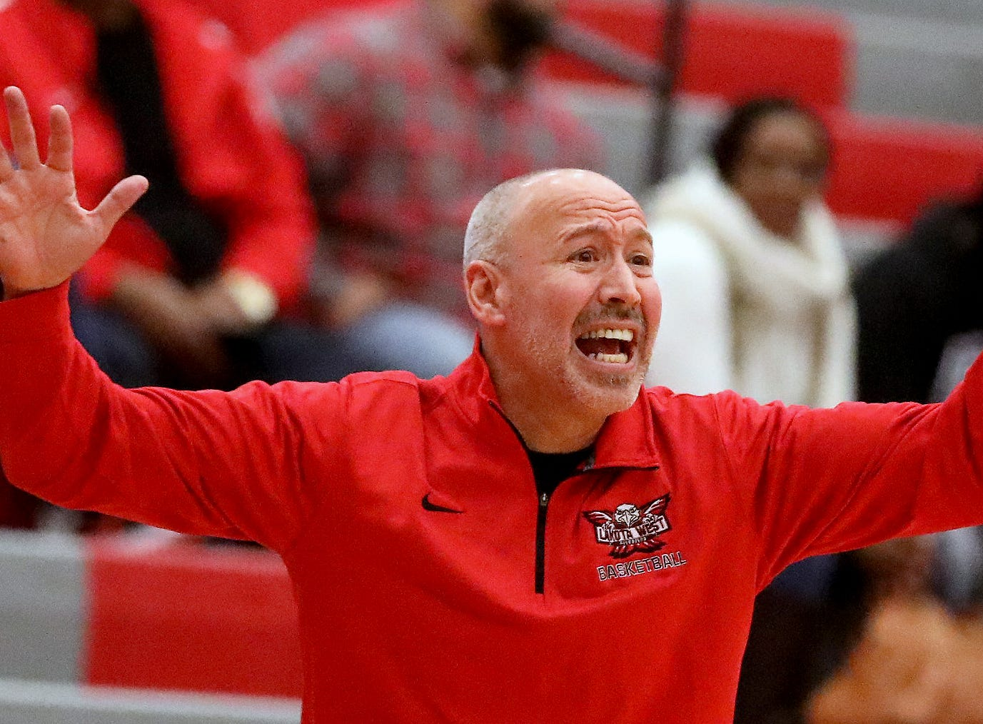 Lakota West head coach Andy Fishman reacts during the Firebireds win over Princeton giving him his 400th win , Wednesday, Jan.16, 2019.