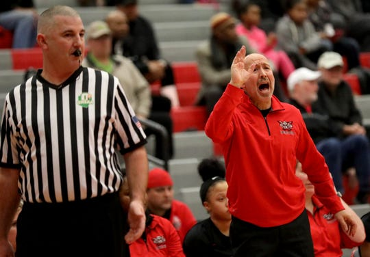 Lakota West head coach Andy Fishman reacts during the Firebirds' win over Princeton, giving him his 400th win , Wednesday, Jan.16, 2019.