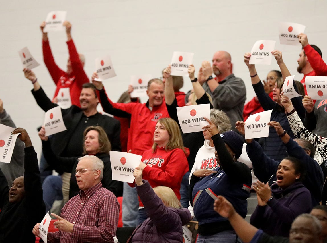 Lakota West fans celebrate  coach Andy Fishmans  400th win over Princeton, Wednesday, Jan.16,2019.