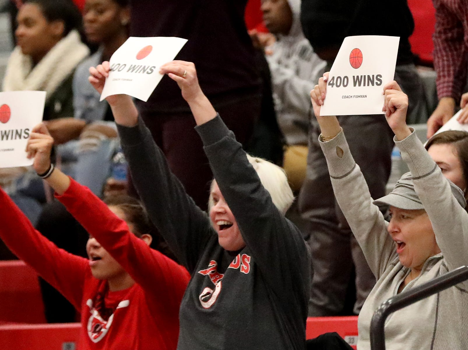 Lakota West fans celebrate head coach Andy Fishmans 400th win over Princeton, Wednesday, Jan.16,2019.