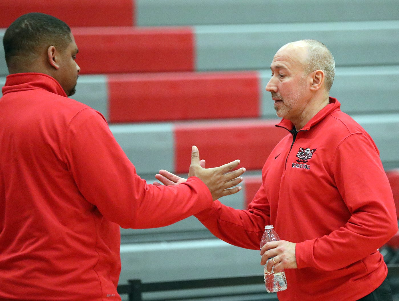 Lakota West head coach Andy Fishman gets congratulations from his assistant coach Carlton Gray after he gets his 400th win over Princeton, Wednesday, Jan.16,2019.