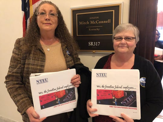 Sheri White(left), president of the NTEU Local 25 in Louisville, and Debbie Mullikin, president of the NTEU in Covington, deliver 17,000 signatures on Thursday demanding Sen. Mitch McConnell, R-Ky., end the shutdown.