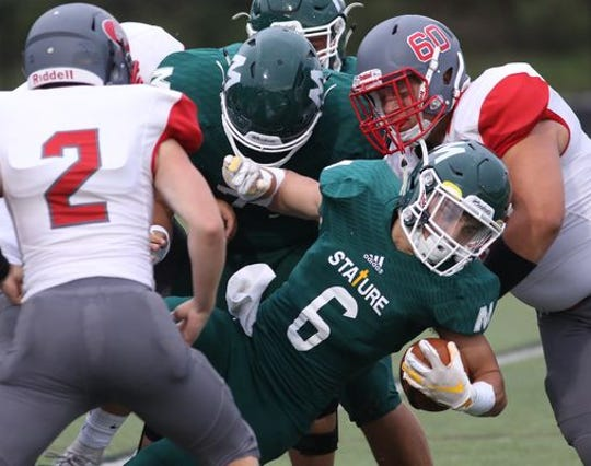 The McNicholas High School Rockets played their first home football game under lights last August.