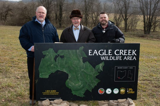 ODNR designated Eagle Creek Wildlife Area as the state's 152nd wildlife area Jan. 11. From left are Robert Perin, Charles Perin Jr. and Charles H. Perin III.