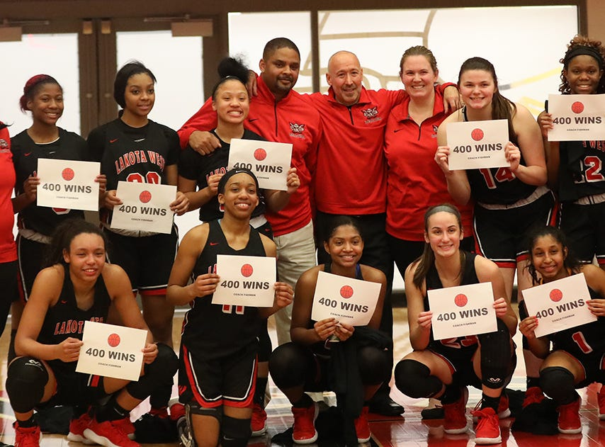 Lakota West head coach Andy Fishman and his team celebrate after he gets his 400th win over Princeton, Wednesday, Jan.16, 2019.
