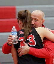 Lakota West head coach Andy Fishman gets a hug from Kailyn Dudukovich   after he gets his 400th win over Princeton, Wednesday, Jan.16,2019.