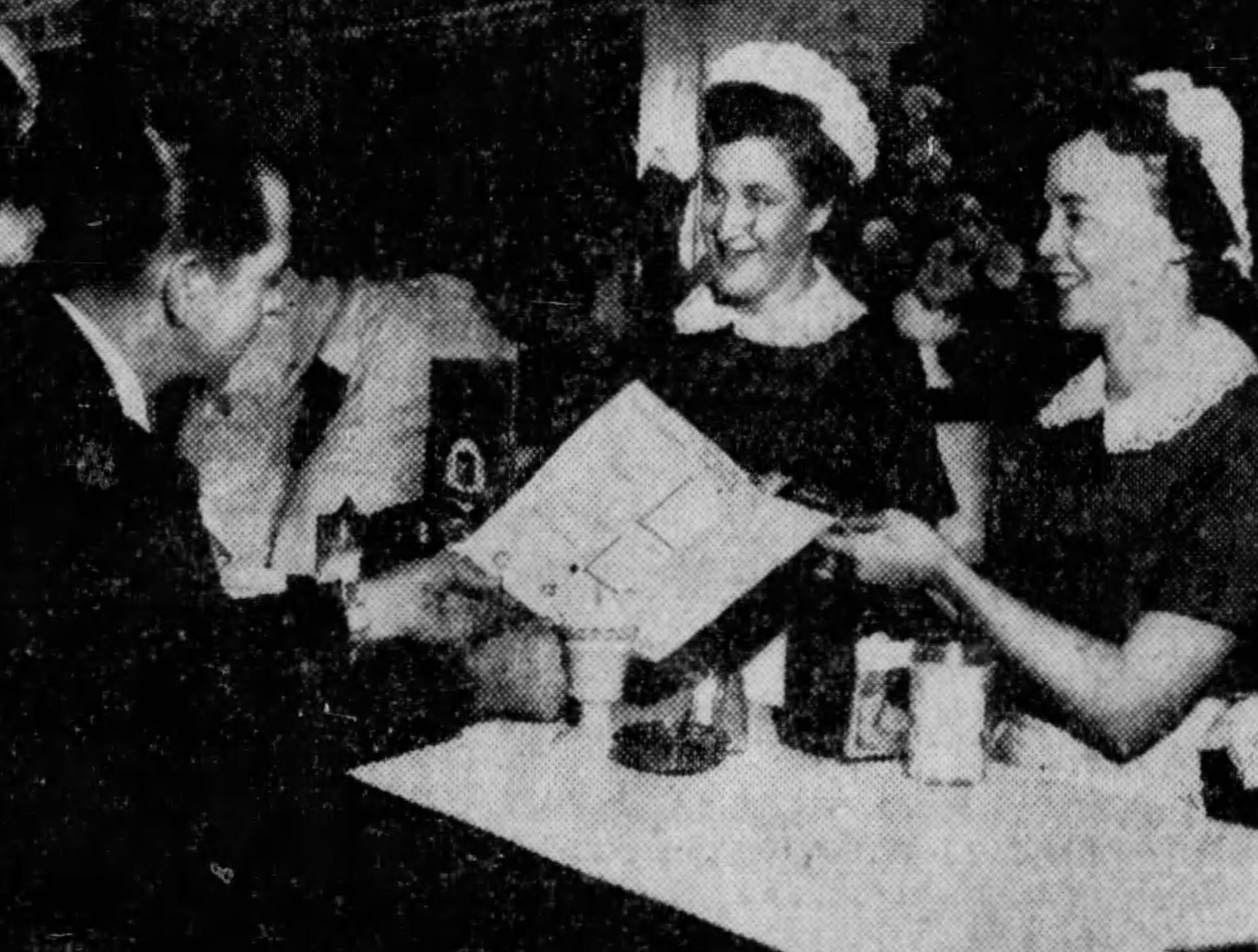 JANUARY 11, 1958: Pictured above is the type of service customers will receive when dining at Cincinnati's newest restaurant. Lloyd Hathaway has a staff of 25 people to provide the finest food possible.