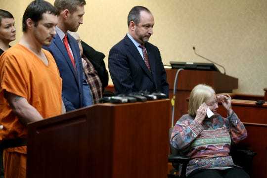 Phyllis Turner, sister-in-law of Sharon McCleary, wipes tears away as she delivers a statement during a sentencing hearing, Thursday, Jan. 17, 2019, in Hamilton, Ohio. Butler County Judge Keith Spaeth sentenced James Geran to life in prison without the possibility of parole. Geran, 46, pled guilty to murder charges in December 2018. He killed Maegan Motter, 27, and then shot at police during a standoff in Trenton the next morning. He shot and killed his girlfriend's mother, Sharon McCleary, at the end of the standoff.