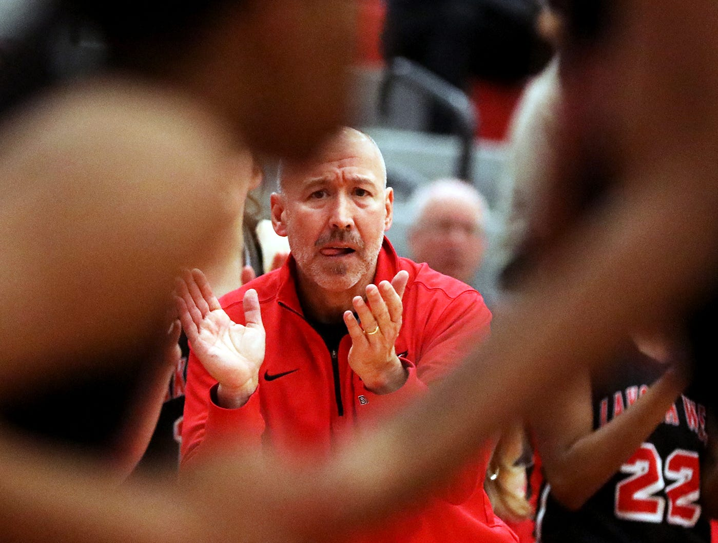 Lakota West head coach Andy Fishman reacts during    the Firebireds win over Princeton giving him his 400th win , Wednesday, Jan.16,2019.